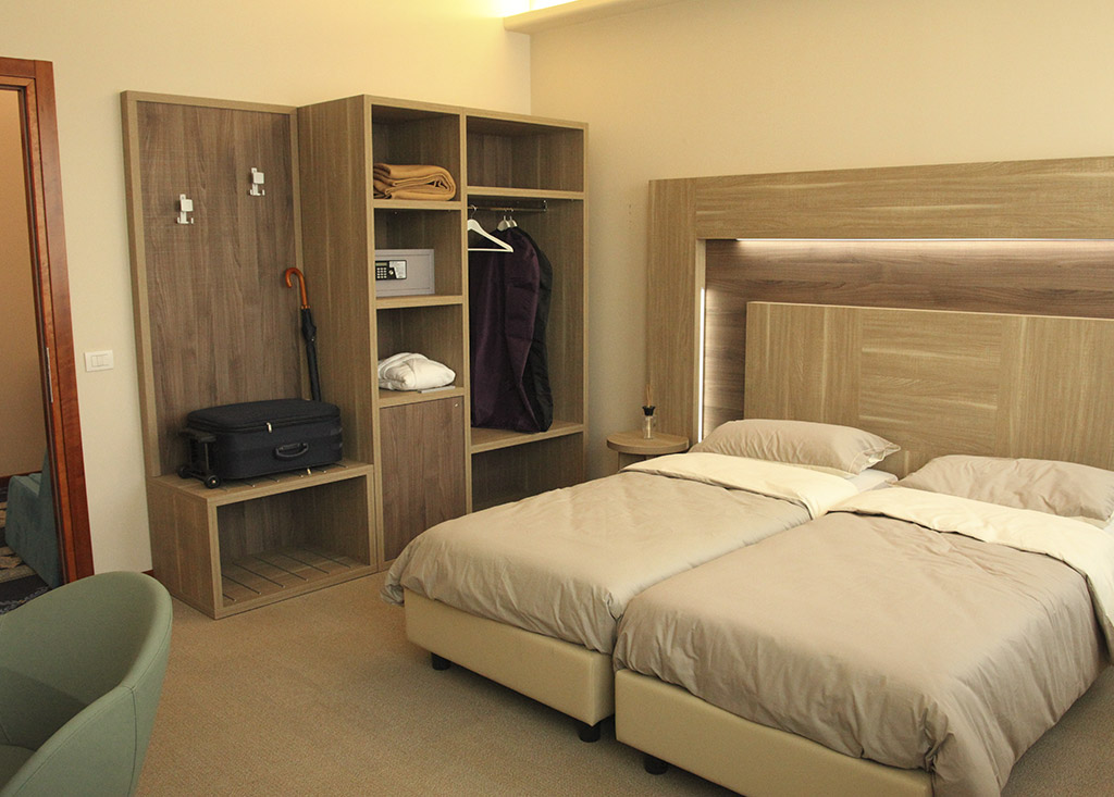 Hotel bedroom composed of headboard, suitcase stand and open wardrobe, model Zeus